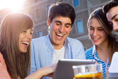 Friends having fun with digital tablets Stock Images