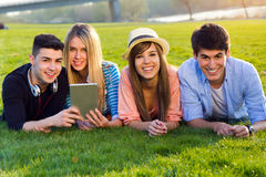 Friends having fun with digital tablets Stock Photo
