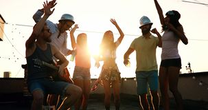 Friends having fun and drinking outdoor on a rooftop get together royalty free stock images