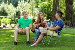 Friends having fun in a garden royalty free stock photography