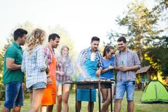 Friends enjoying bbq party royalty free stock photography