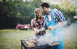 Friends enjoying bbq party royalty free stock images