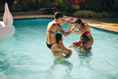 Friends having fun in the holiday resort pool Stock Photo