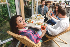 Friends having fun during lunch together stock photography