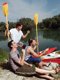 Friends having fun near river Royalty Free Stock Photo