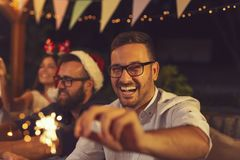 Friends having fun at New Year`s Eve party royalty free stock photography