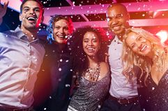 Friends having fun at party with confetti Stock Image