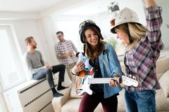 Friends having fun and partying in house and playing music Stock Photography