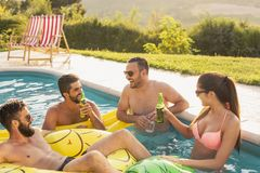 Friends having fun at a poolside party stock images