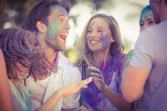 Friends having fun with powder paint in the park Stock Images