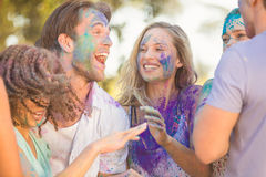 Friends having fun with powder paint Stock Photography