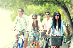 Friends having fun riding bicycle together Stock Photo