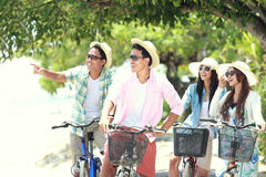 Friends having fun riding bicycle together royalty free stock photography