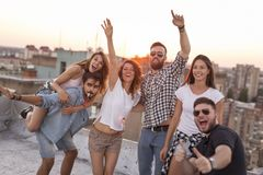Friends having fun at a rooftop party royalty free stock photos