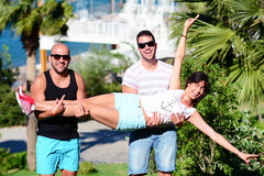Friends having fun on a sea background Royalty Free Stock Photography