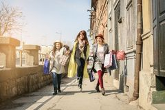Friends having fun during shopping in the city. stock image