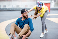 Friends having fun with skateboard outdoors Royalty Free Stock Photos
