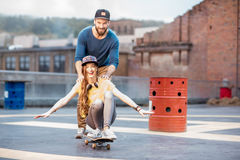 Friends having fun with skateboard outdoors Stock Image