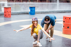 Friends having fun with skateboard outdoors Royalty Free Stock Images