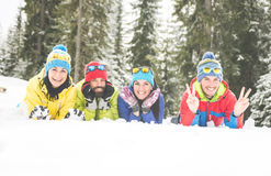 Friends having fun on the snow stock images