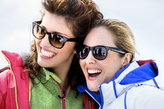 Friends having fun in the snow Royalty Free Stock Photos