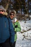 Friends having fun in snowy landscape Stock Photo