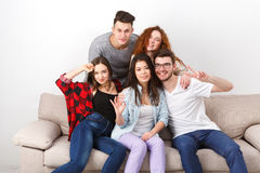 Friends having fun, taking selfie at home party Stock Photo