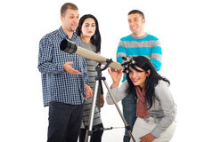 Friends having fun with telescope stock photography