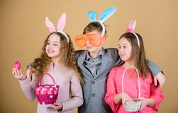 Friends having fun together on Easter day. Ready for eggs hunt. Children with little basket ready hunting for Easter stock image