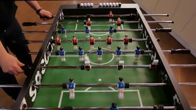 People enjoying table soccer game. Close up of table football kicker game. Friends having fun together playing foosball. Colleagues playing table football on stock video