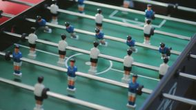 Friends having fun together playing foosball. Colleagues playing table football. On break. Office people enjoying table soccer game. Close up of table football stock video footage