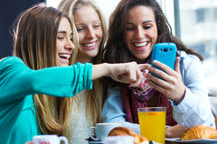 Friends Having Fun With Smartphones Stock Images