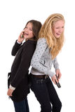 Friends having a good laugh. Two teenage girls having a laugh while on their phone Royalty Free Stock Image