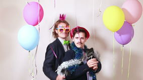Friends having great time in party photo booth stock video