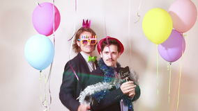 Friends having great time in party photo booth stock footage