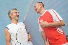 Friends having a joke. Badminton Royalty Free Stock Photos