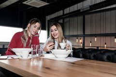 Friends having lunch Stock Images