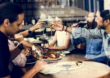Friends having lunch time together Stock Photography