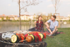Friends having outdoor barbecue. Grill with various barbecue, selective focus Stock Photo