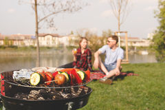 Friends having outdoor barbecue. Grill with various barbecue, selective focus royalty free stock photos