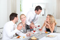 Friends having a party Stock Images
