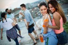 Friends having party on top of the roof. Fun, summer, city lifestyle and friendship concept stock images