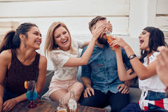 Friends having partying on rooftop Stock Image