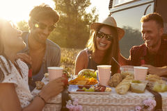 Friends having a picnic beside a camper van, close up Royalty Free Stock Images
