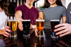 Friends having a pint. In a bar stock images