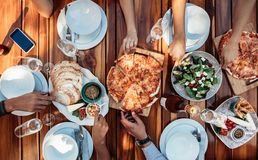 Friends having pizza at party stock images