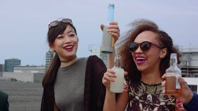 Friends having rooftop party stock footage