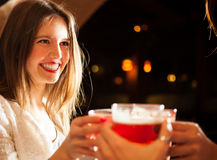 Friends having a round of drinks Stock Photography