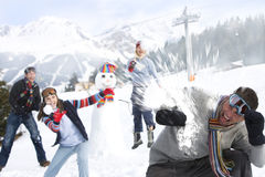 Friends having snowball fight Stock Photos