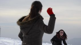 Friends having snowball fight stock video footage